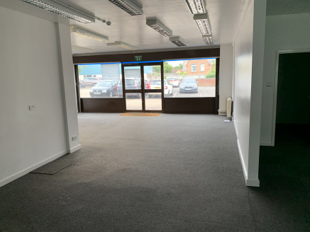 Totaling 1,090 sq ft. Three off road parking spaces. Short walk to town centre. Potential Showroom Use. Available Now.