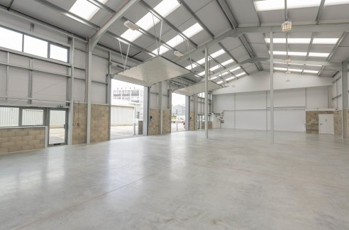 DESCRIPTION:\n\nUnit 5 is an attractive mid terrace industrial/warehouse unit of steel portal frame construction with block/metal clad elevations under an insulated roof. The property benefits from three phase power, high bay lighting an electronic a...