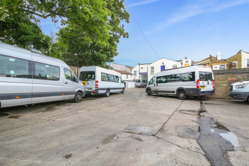 The property comprises two office buildings, a warehouse and an open storage yard. The site is currently occupied by a transport company, the yard being used for storage and the warehouse for vehicle repairs. The loading bay to the yard is 4m high by...
