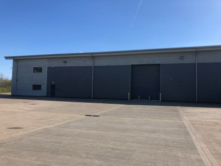 The property comprises a modern end of terrace warehouse unit of steel portal frame with brick and metal cladding with a high specification including the following:-