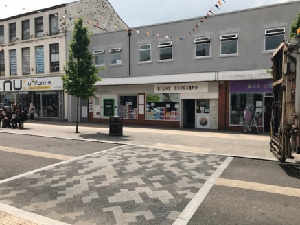 **UNDER OFFER**  A double fronted ground floor unit within a parade of shops with a generous frontage to Market Street of 12.1m (39ft 8'').  The ground floor sales area is in excess of 200 sq m together with a large stockroom and offices to the rear,...