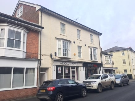 The property comprises a ground floor retail unit set within a small parade.  The space includes display windows, main retail space WC and kitchenette at the rear.  To the rear the property benefits from an allocated parking space.
