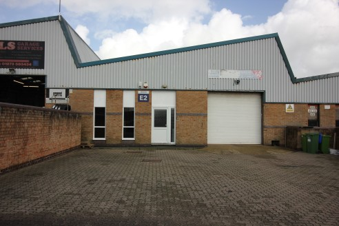 The property is comprised of a purpose built steel framed light industrial/warehouse unit with part brickwork and part blockwork walls and a concrete floor.