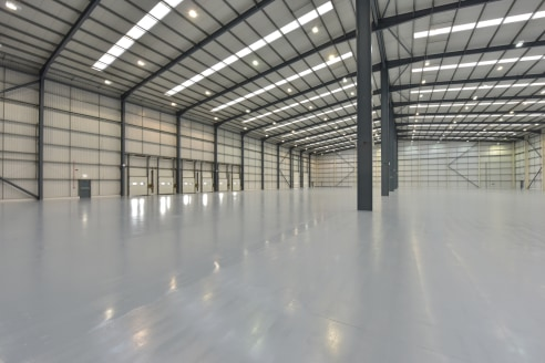 Detached unit on self-contained site. Steel portal frame construction. Profile metal clad elevations beneath insulated profile clad roof with translucent roof lights. Internal eaves height of 12m. 6 dock and 2 level access loading doors. Integral two...