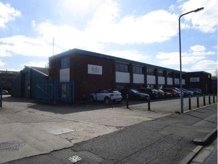 The property comprises a detached industrial unit, incorporating workshop and stores to the rear, with two storey offices and despatch bay the front and adjacent car parking. The offices are of two storey brick clad construction under a flat roof, wi...