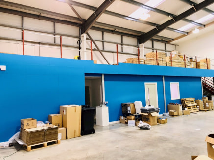 Mezzanine Storage Area within a modern industrial unit on Bury South Business Park.  The business park is a 3.5 acre mixed use modern development.   The Mezzanine Level storage area is approximately 917 Sq ft and is within fully insulated steel porta...