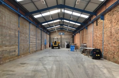 The property comprises a substantial warehouse/distribution facility, which is essentially arranged in two bays with integral brick built, single storey office and toilet block to the front. The warehouse is of part steel truss frame (main bay) and p...