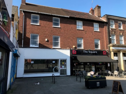 The property comprises a three storey retail premises, with open plan retail sales and ancillary office/storage to the ground floor, kitchen, office/sales and WCs to the first floor and additional office/storage to the second floor. To the rear is an...