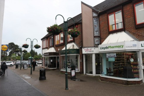 The premises comprise a prominent self-contained, open-plan ground floor A1 retail shop located next to Lloyds Pharmacy and opposite Lidl and the NHS Family Medical Centre.