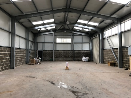 The property comprises a single storey, new build industrial/warehouse unit clad in a combination of brick and blockwork under a sheet metal pitched roof incorporating translucent roof panels. Access is provided by way of two roller shutter loading d...