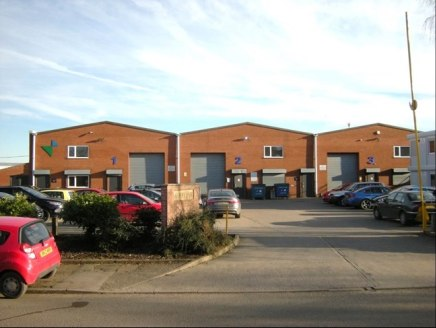 Terrace of 3 industrial/warehouse units constructed c. 1990.  Brick/block construction with a steel portal frame and equal pitched fully lined corrugated profile steel roof.  Each of the units has the following:  High level sodium lighting  Manual ro...