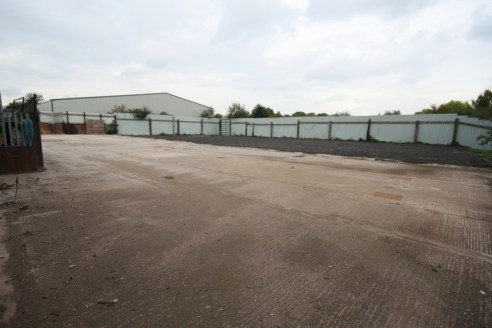 p>\n The yard is located via a set of metal gates and the main entrance part of the yard is concrete slab with a disused weigh bridge to the rear of the yard (not in working order) and a further porta cabin to the right of this. This area measures 8,...