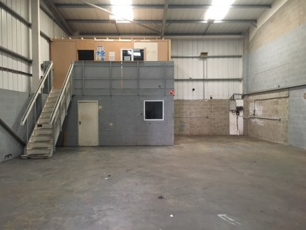 The property comprises an industrial/warehouse unit being constructed on a steel portal frame with block and metal sheet clad walls and under a pitched sheet clad roof incorporating translucent panels.  Drive in access is by way of a roller shutter l...