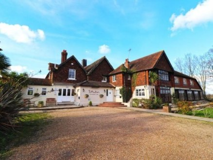 Popular 12 bed hotel, restaurant and wedding venue with stunning views of the South Downs.  FOR SALE