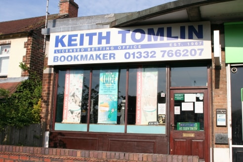 The premises comprise an end of terrace retail unit of brick construction with flat roof with timber display windows and timber fascia board.   Internally the layout is open plan from front to rear leading to a door which provides access to the kitch...
