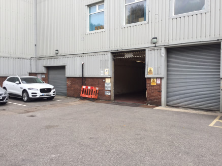 The premises briefly comprise a warehouse/ industrial unit located within Calderdale Business Park on the outskirts of Halifax Town Centre.  The unit itself benefits from having a solid concrete floor, fluorescent strip lighting and a roller shutter...