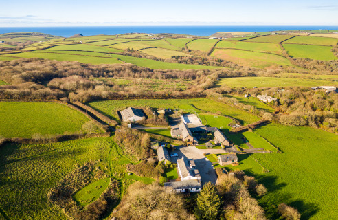 Farmhouse and 10 letting cottages in over 36 Acres  FOR SALE