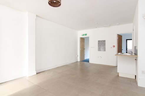 The property is located on the west side of New Cross Road and is a two-minute walk from New Cross station. The unit forms part of a cluster of artistic and creative operators on a busy parade, with companies such as the MMX Art Gallery, the London C...