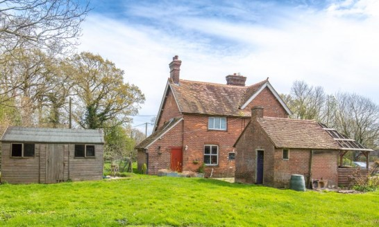 Residential smallholding with a Victorian farmhouse, pasture, woodland and an agricultural outbuilding. In all about 10.4 acres.