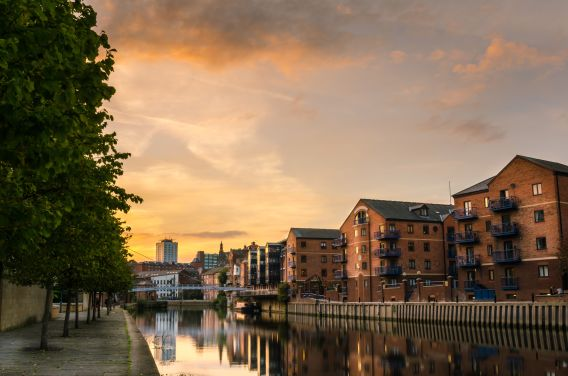 A photo of converted warehouse space alongside a canal in Leeds