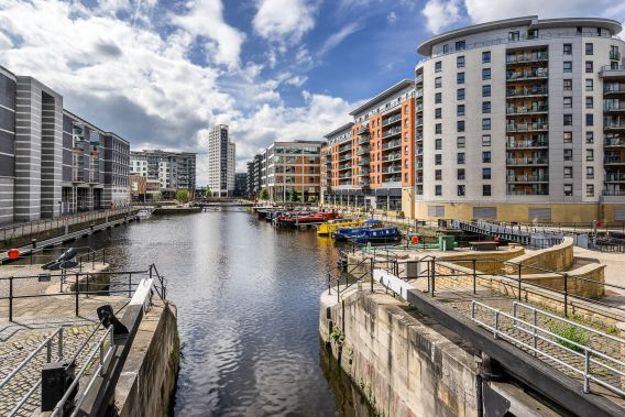 Photograph of Clarence Dock area of Leeds, new builds surround the canal