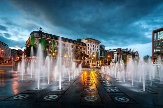 A photo of Piccadilly Square in Manchester, taken of the fountains at night.