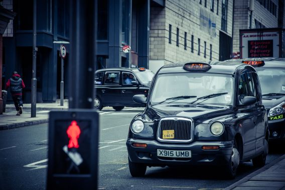 Scene of London taxis with a pedestrian crossing