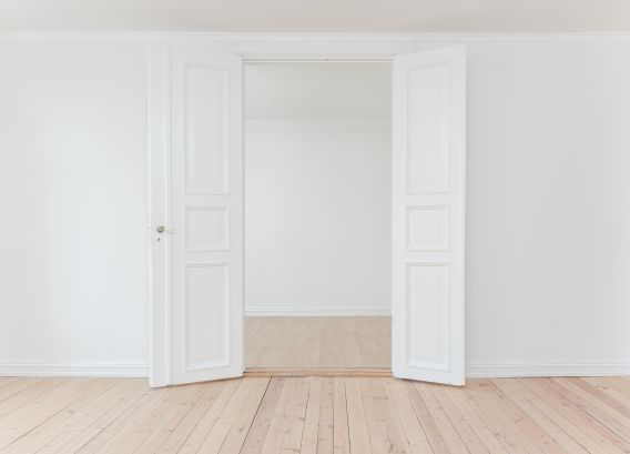 Interior image of an empty building with a white door