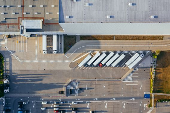 Exterior aerial photograph of warehouse space with lorries parked outside