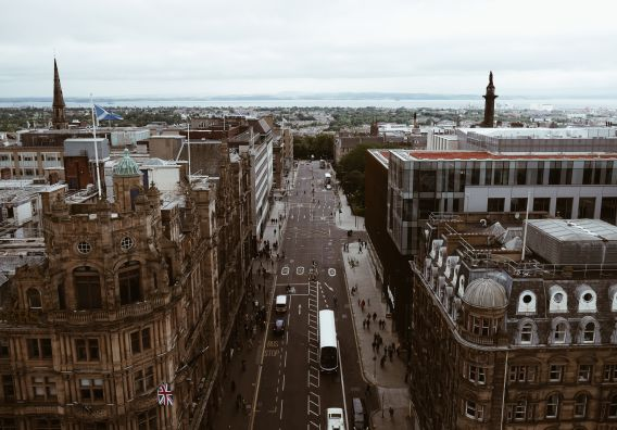 Image of office buildings in Edinburgh, set against a busy street