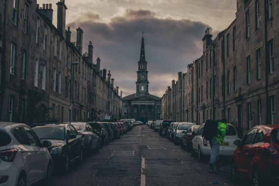 Image of a street in Edinburgh's New Town, of cars parked along the road