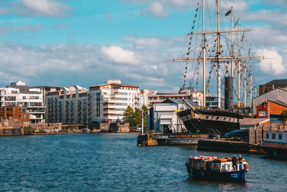 Photo of Bristol harbour on a sunny day with the restored SS Great Britain ship prominent