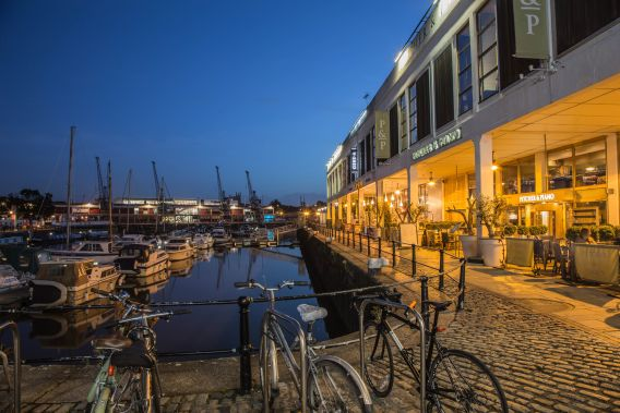 Image of Bristol harbourside at night, focusing on the restaurants by the water