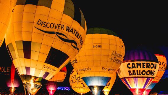 Photo of lit up hot air balloons at night