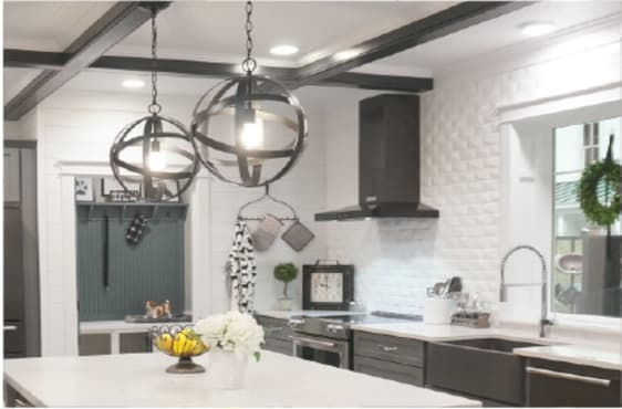Kitchen sink area with flush lighting and pendant lights.
