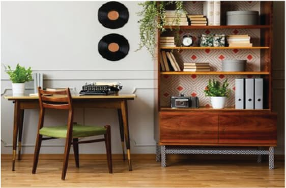 Warmly-lit office with 60s-inspired bookcase, desk, and chair.