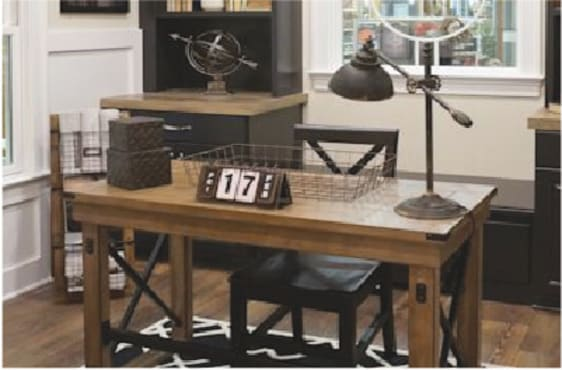 Vintage-style office with solid wood desk, chair, and adjustable desk lamp.