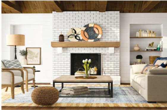 Airy living room with exposed wood beams and finial floor lamp with a brick fireplace.