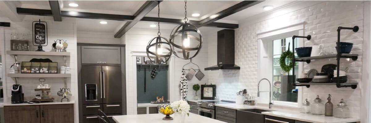 Kitchen with spherical pendant lights hanging over a breakfast bar