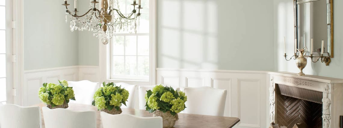 sunny dining room painted in pale colors and white