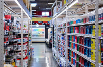 an aisle of paint products in hartville hardware's paint department