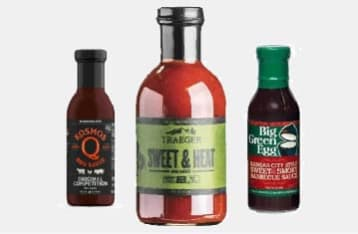 A sampling of the sauces we offer, including Kosmos Q Competition BBQ Sauce, Traeger Sweet & Heat sauce, and Big Green Egg Kansas City Sweet & Smoky sauce