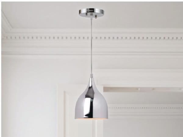 Chrome pendant light hanging from a clean white ceiling.