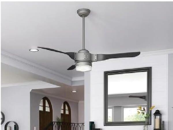 3-blade metal ceiling fan in a white-walled room.