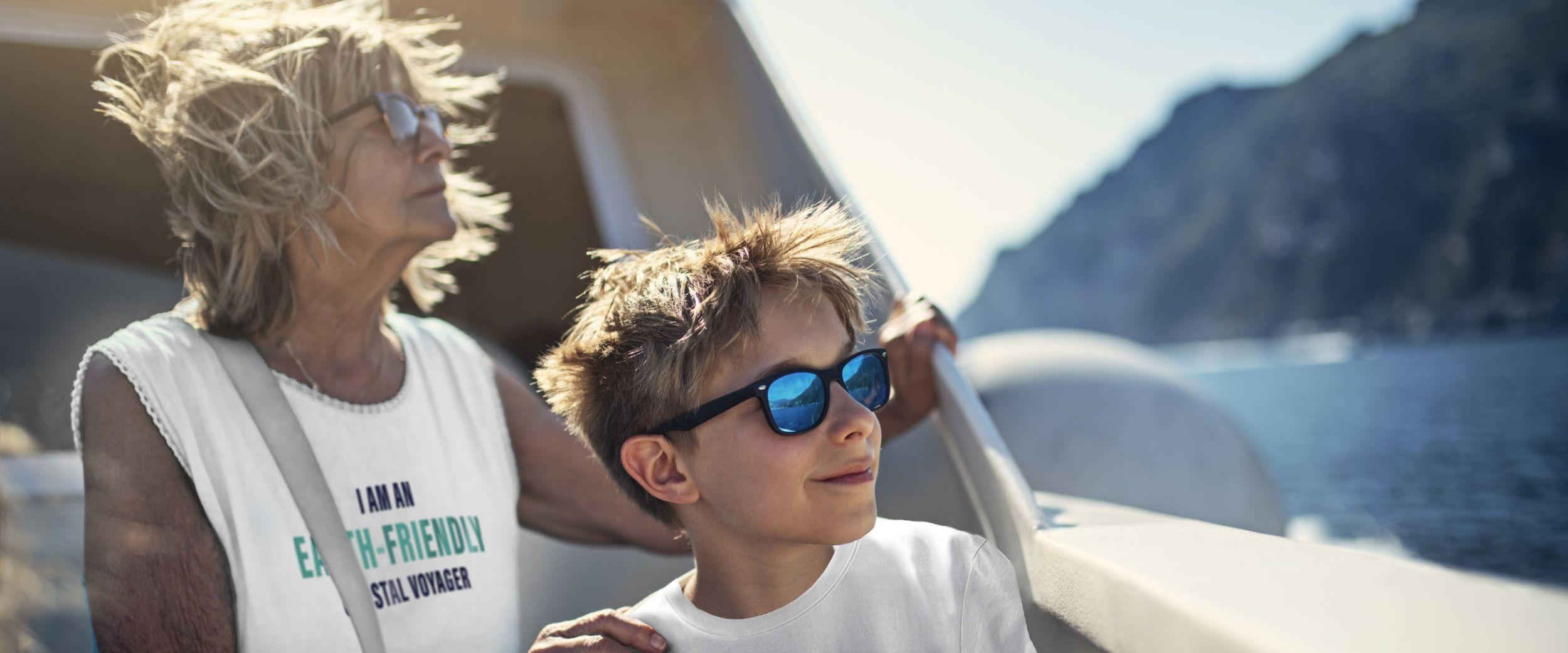 Grandma and grandchildren with earth-friendly coastal voyager t-shirts. Getty/Havila.