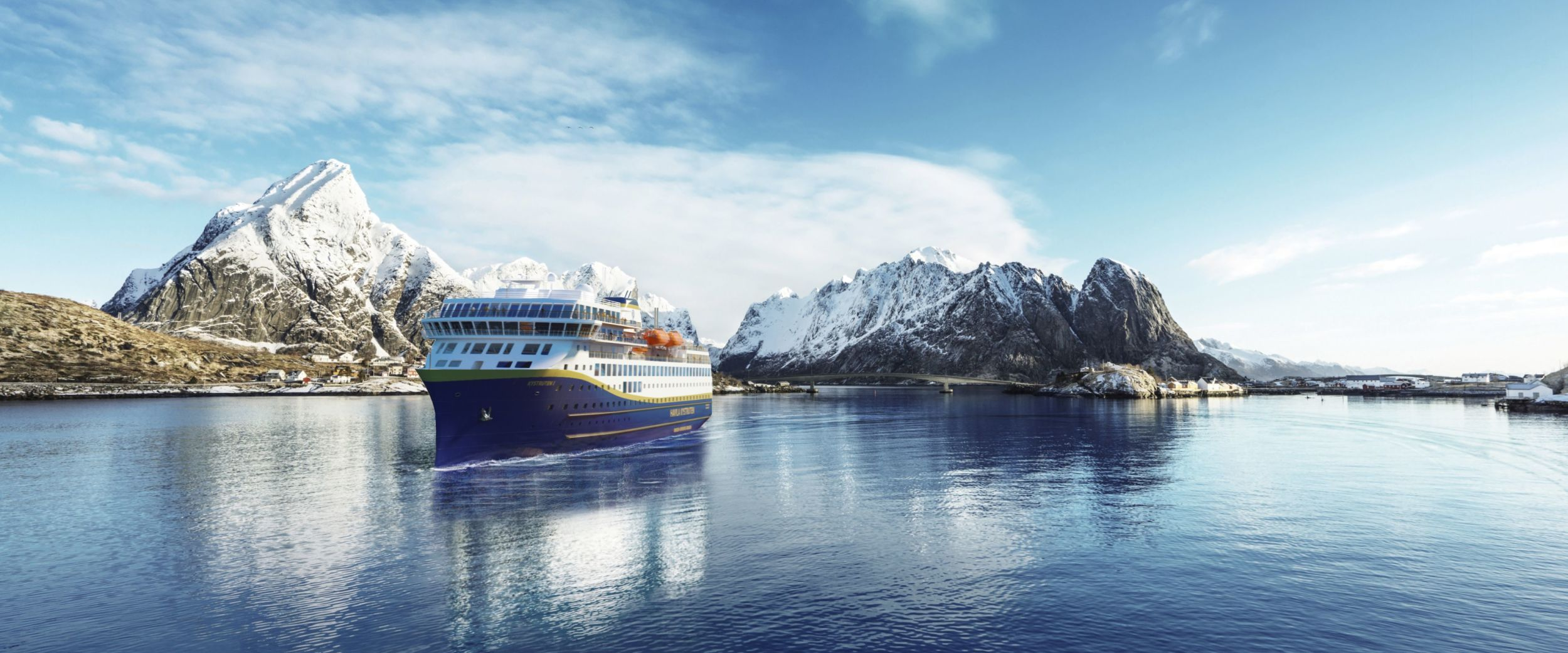 Havila ship on a calm sea with the Lofoten mountains in the background.