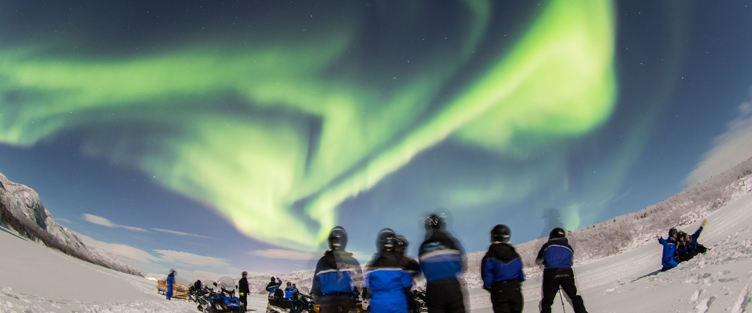 Snowmobiling under the northern lights, photo: Nicolas Vera-Ortiz