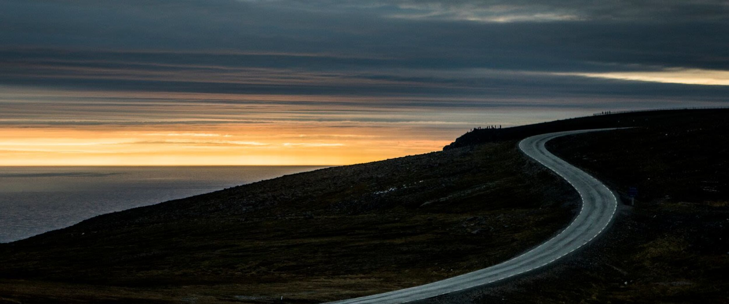 The road to North Cape in the midnight sun. Photo: Christian Roth Christensen, visitnorway.com