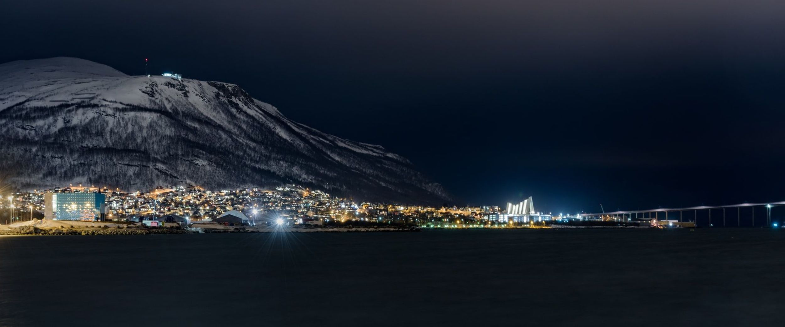 Tromsø in the night with Ishavskatedralen. Photo: Ludovic Charlet, Unsplash