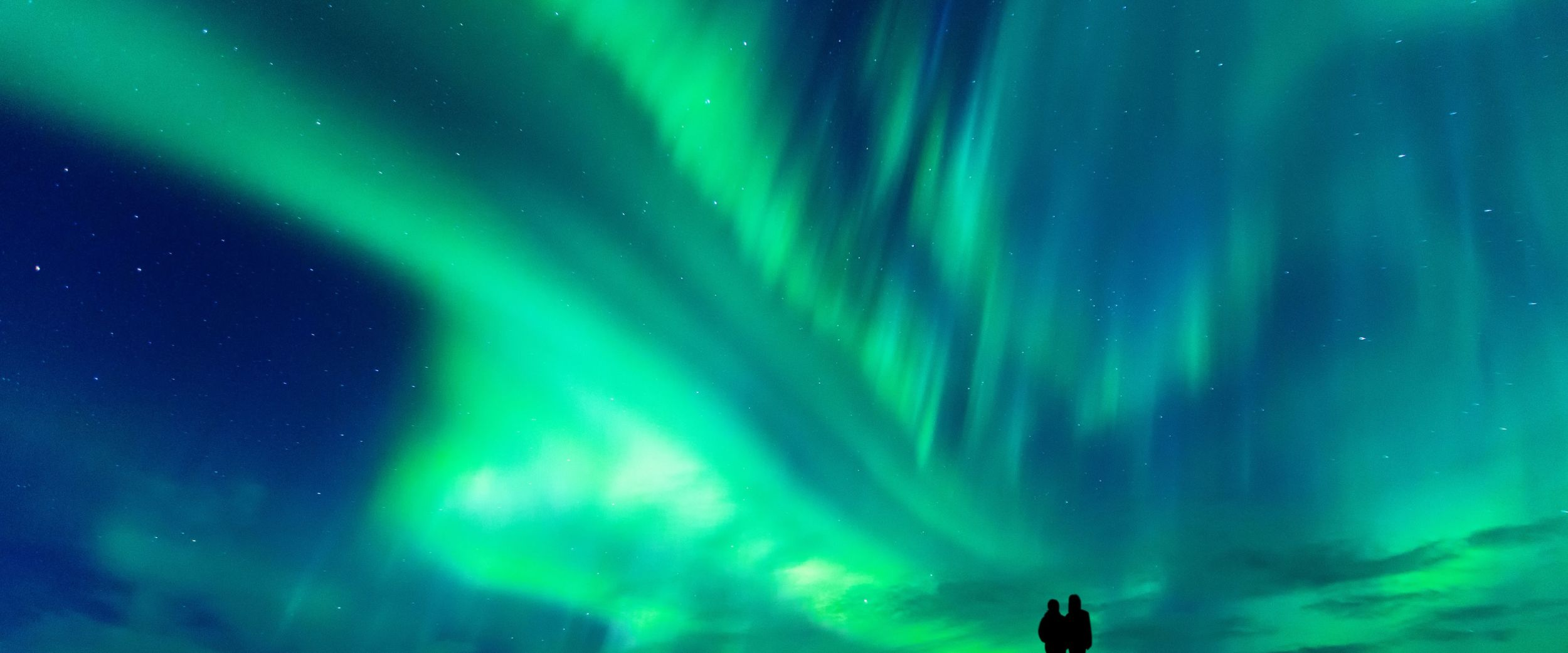 Couple enjoying the Northern Lights.